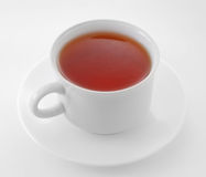 Cup of tea. Against a white royalty free stock photo