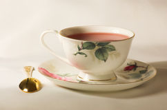 Cup of tea. Drop of tea on white table-cloth Royalty Free Stock Photography