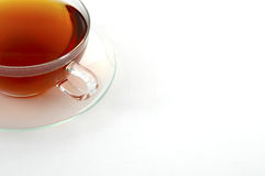 Cup of tea. Cup of black tea with copy space isolated on a white background royalty free stock images