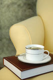 Cup of Tea. And book on chair Stock Images