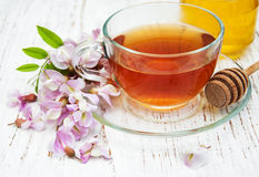 Cup of tea with acacia flowers Stock Photography