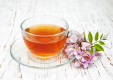 Cup of tea with acacia flowers Royalty Free Stock Photography