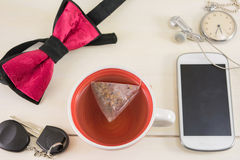 Cup of tea and accessories for successful day Stock Image