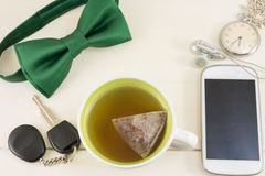 Cup of tea and accessories for successful day Stock Photo