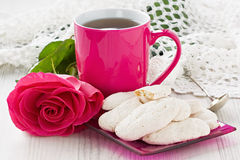 Cup tea, almond cookies and rose Stock Image