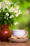 Cup of tea and anemones Stock Photo
