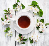 Cup of tea with apple blossoms Royalty Free Stock Photography