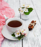 Cup of tea with apple blossoms Royalty Free Stock Photos