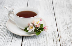 Cup of tea with apple blossoms Royalty Free Stock Images