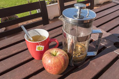 Cup of tea with apple, breakfast in the garden Stock Image