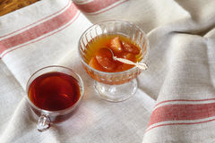Cup of tea and apple jam dessert or confiture Royalty Free Stock Photo