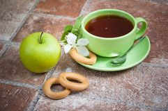 Cup of tea with an apple Stock Photography