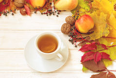 Cup of tea, apples, pears, nuts and autumn leaves. autumn Still Stock Photography