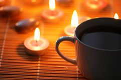 Cup of tea and aromatic candle Royalty Free Stock Photography