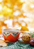 A cup of Tea and autumn leaves. A cup of Tea and autumn yellow leaves stock photography