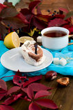 Cup of tea with autumn leaves of wild grapes Stock Photo