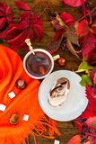 Cup of tea with autumn leaves of wild grapes Royalty Free Stock Image