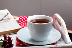 Cup of tea with autumn leaves of wild grapes Royalty Free Stock Images