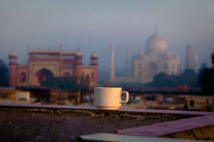 Cup of tea on the background of the Taj Mahal stock image