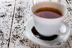 Cup of tea on a background of tea leaves Stock Photo