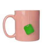 Cup with tea bag Stock Photos