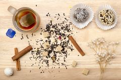 Cup with tea bag and cake Royalty Free Stock Image