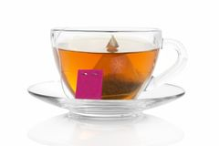 Cup with a tea bag on saucer Stock Images