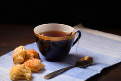 Cup of tea with a bag of tea leaves and home-made cookies Stock Image