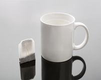 Cup and tea bag Royalty Free Stock Photos