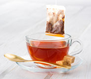 Cup of tea with bag on white wood Royalty Free Stock Photography