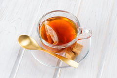 Cup of tea with bag on white wood Stock Images