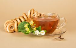 Cup of tea, bagels, linden and jasmine flowers Stock Image