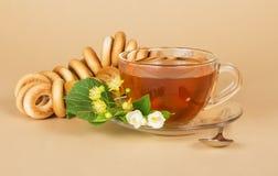 Cup of tea, bagels, linden and jasmine flowers Stock Image