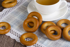 Cup of tea and bagels. On table stock photography