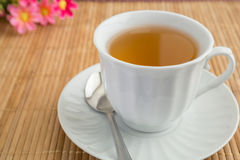 A cup of tea on bamboo mat Stock Images