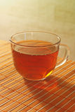 Cup of tea on a bamboo table cloth Royalty Free Stock Photography