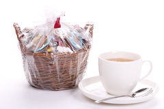 Cup of tea and a basket of cookies. Cup of tea and a basket of multi coloured cookies Royalty Free Stock Photos
