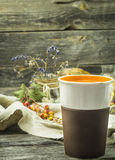 The Cup of tea on a beautiful wooden background with lemon and herbs, winter ,autumn Stock Photo