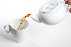 Cup of tea being poured Royalty Free Stock Photos