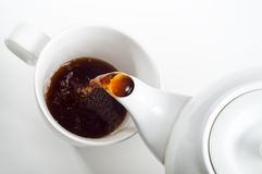 Cup of tea being poured stock images