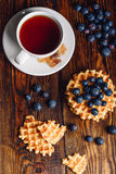 Cup of Tea with Belgian Waffles and Blueberries. Royalty Free Stock Photography