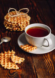 Cup of Tea and Belgian Waffles for Dessert. Stock Photo