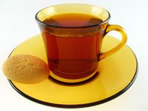 Cup of tea and biscuit. On the white Stock Photos