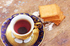 Cup of tea with biscuit Royalty Free Stock Photos