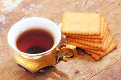 Cup of tea with biscuit Stock Photos
