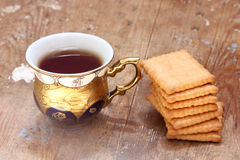Cup of tea with biscuit Royalty Free Stock Photography