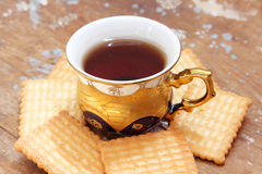 Cup of tea with biscuit Royalty Free Stock Image