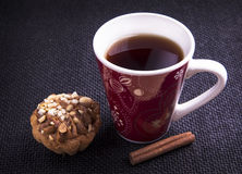 A cup of tea with biscuit and cinnamon Royalty Free Stock Images
