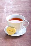 Cup of tea and biscuit Stock Image