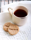 Cup of tea and biscuit Royalty Free Stock Images